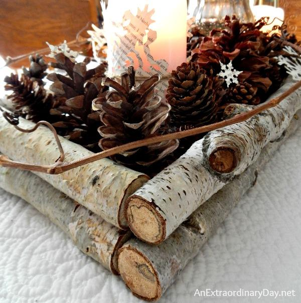 birch-pine-cones-and-book-pages-woodland-centerpiece