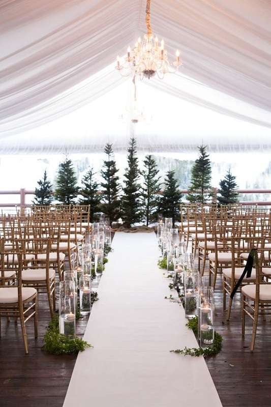 Ented Wedding Ceremony With Evergreen Trees And Candles